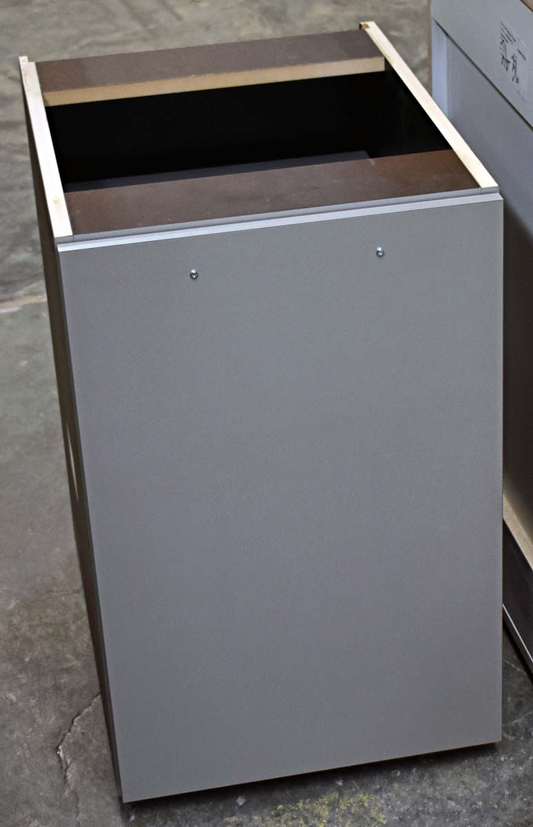Self-closing base cabinet with waste containers