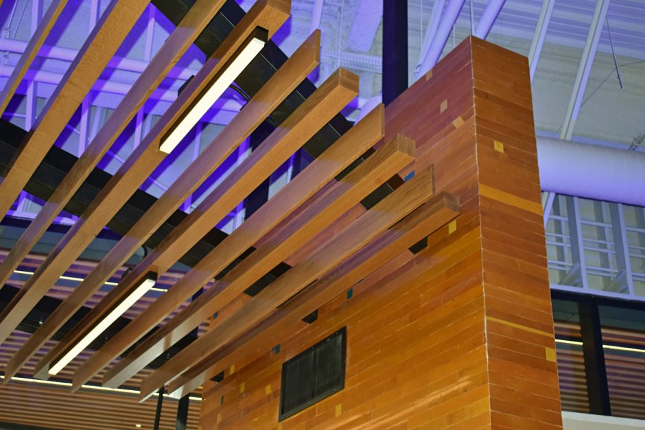 This detailed shot shows the wood slat ceiling located at the lobby entry.