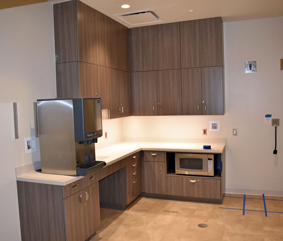 Check out the upper and lower cabinets in the break room area.