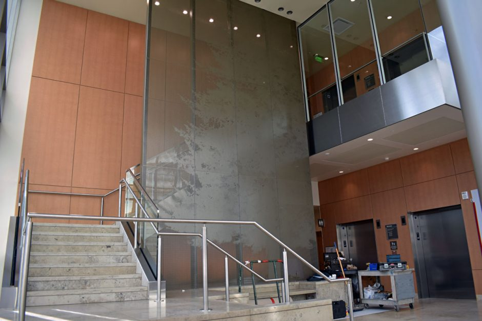 Check out the metal stair stringer panels and acoustic wall paneling in the lobby.
