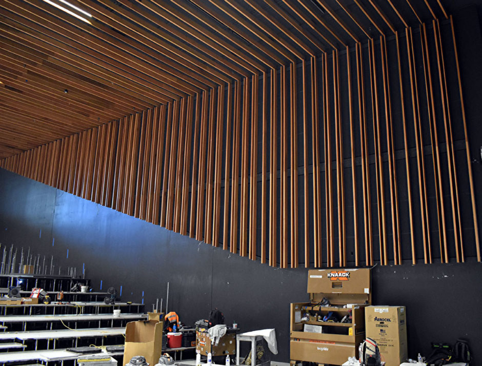 Custom stained poplar used for the walls and ceiling is featured in the Performing Arts Center inside Building 2B.