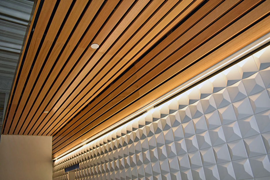 The ceilings in all of the break rooms feature rift white oak veneer.