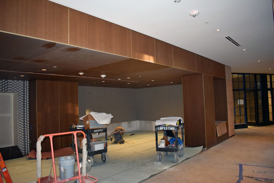 Dooge Veneer fumed white oak coco cognac is used for the wall paneling and ceiling found on level 2. This space is for the library.