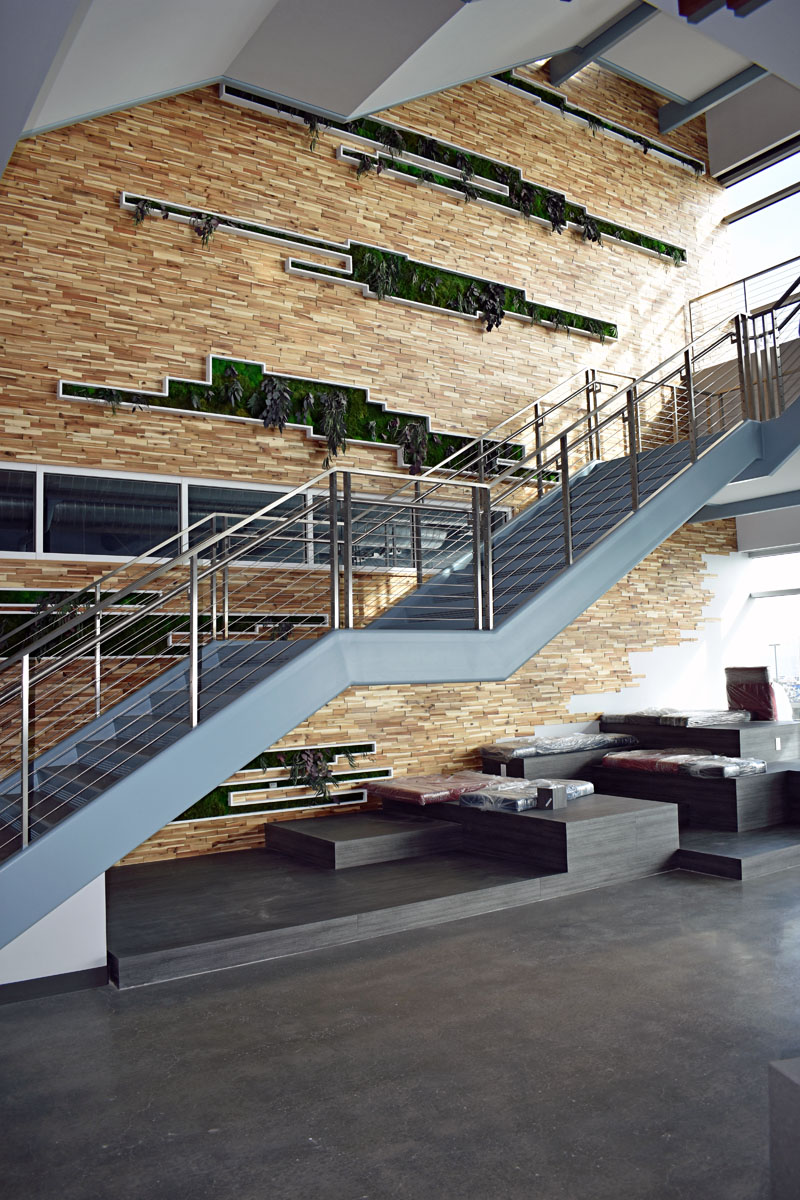 The stepped seating underneath the stairs is located at the base of the feature wall on the second floor.