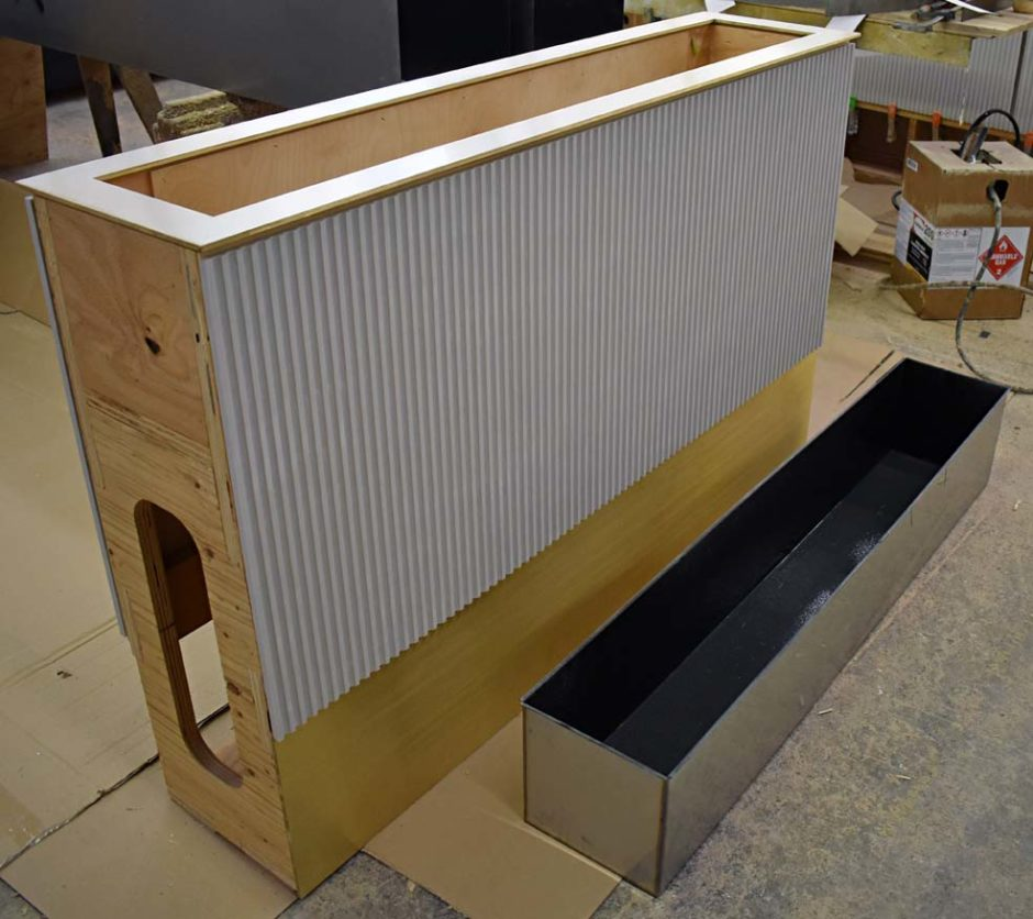 The planter boxes feature a stainless steel liner, shown at right.