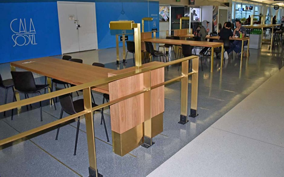NWD's boxed end walls are placed up against long oak tables, provided by others, inside the terminal. The end walls include an LED lamp to add extra lighting to the seating areas.