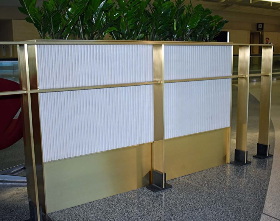 In addition to the potted plants, the planter boxes feature fluted corian and brass.