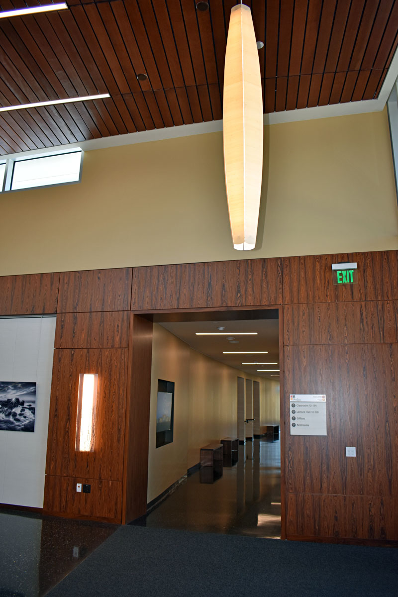 This paneling covers the north and south entrances to the Gallery.