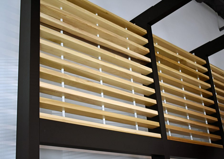 The wall features plain-sliced poplar with a semi-gloss lacquer finish.