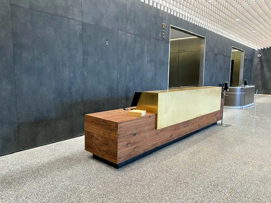 The reception desk in the lobby area features walnut. The bronze on the desk was supplied by metal fabricator Jason Elliott of Elliott Speciality Metal in Eugene.