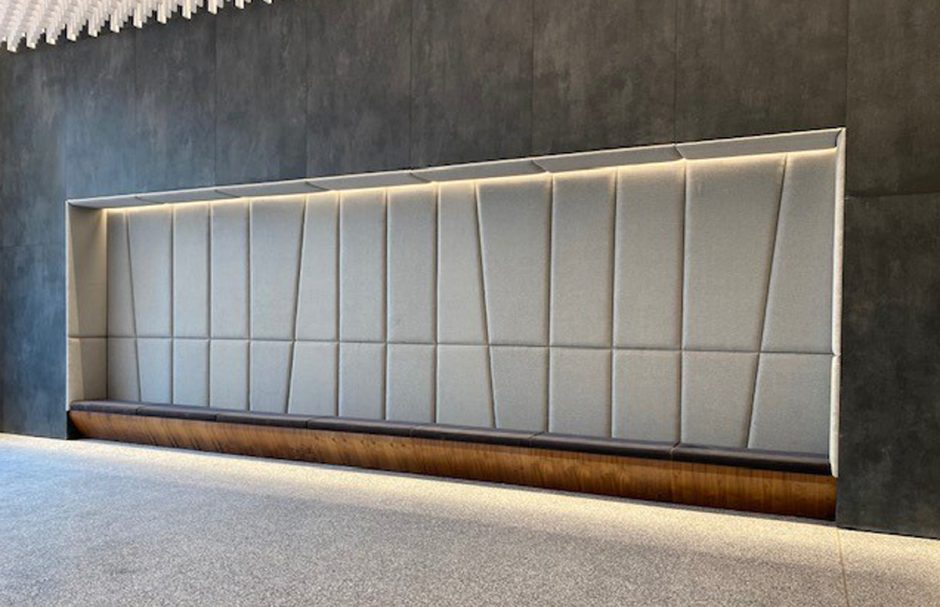 This walnut bench offers added seating in the lobby.