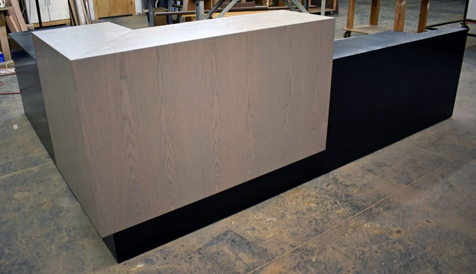 The lobby reception desk for the Warriors tenant improvement project is shown inside Northwestern Design's Custom Shop.