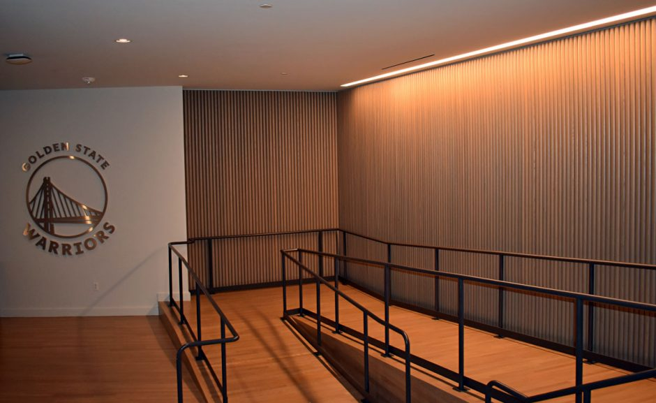 The wood half-dowel wall is located in the reception area.